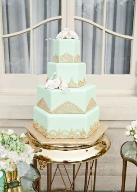 multi-tier mint wedding cake with gold lace