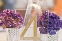 25 acrylic glitter table numbers seem to float in the air
