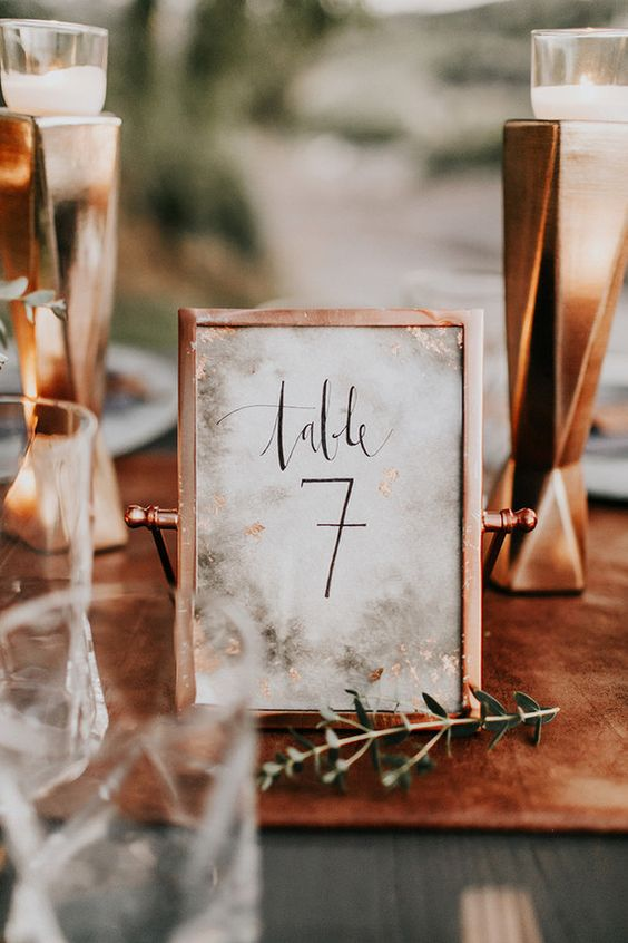 framed copper table number with a white backdrop