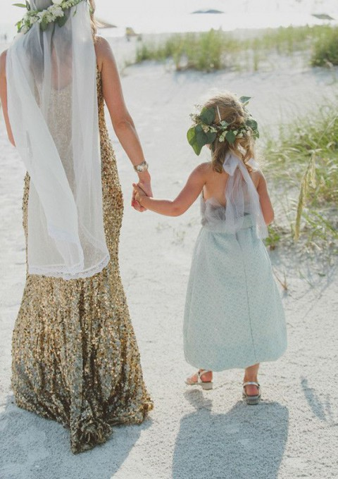 gold sequin wedding dress and a mint flower girl dress