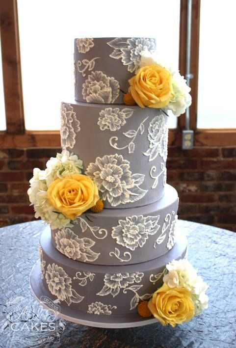 grey wedding cake with lacy flowers and yellow roses