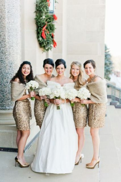 gold sequin mini dresses with neutral faux fur for a holiday wedding
