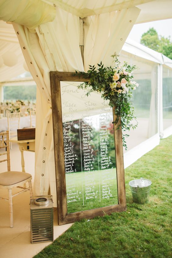 mirror seating plan in a rustic frame with foliage