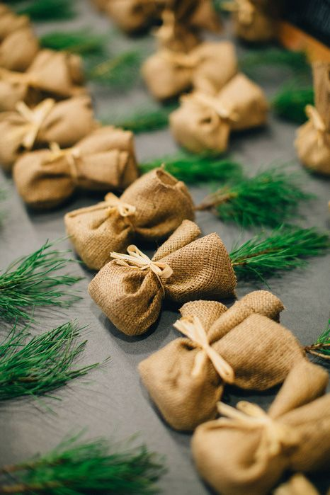 fir sprigs in burlap as cool winter wedding favors