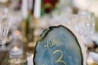 27 geodes are hot in wedding decor, and you can write table numbers with gold on them