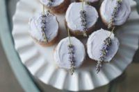 27 grey cupcakes topped with lavender