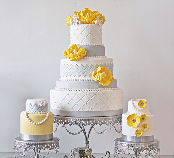 multiple cakes in grey, yellow and white