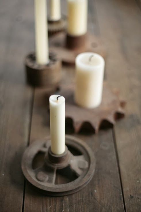 old gears as industrial candle holders