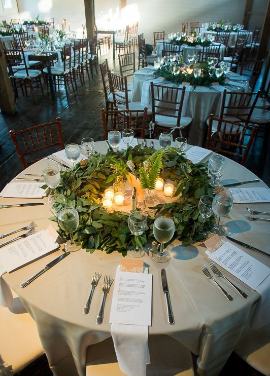eucalyptus wreath, candles and fern for a winter wedding centerpiece