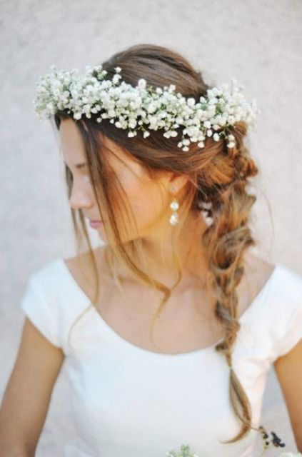 messy braid and a baby's breath crown for a summer bride