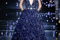 28 midnight blue wedding gown with a deep plunging neckline and a star belt