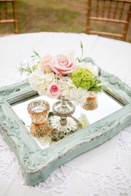 mint frame mirror for displaying candles and flowers