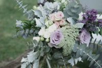 28 pale purple and silver flower arrangement for a rustic wedding ceremony