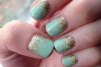 29 mint nails with gold glitter decor