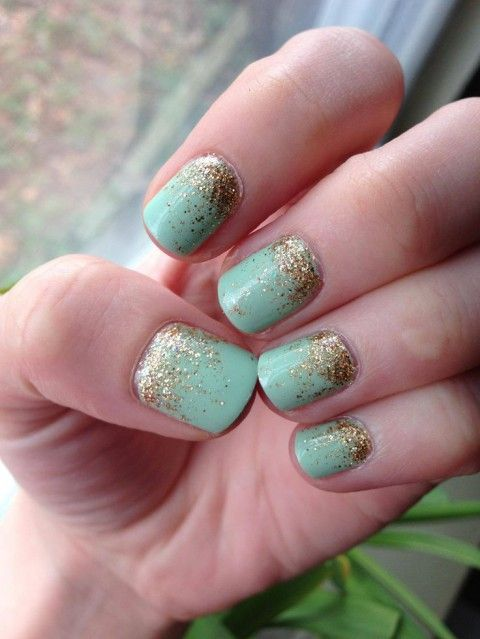 mint nails with gold glitter decor