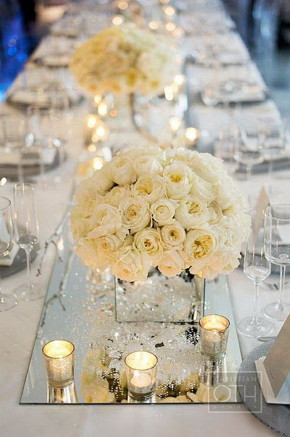 mirror vases and table runners create a dimension and reflect light