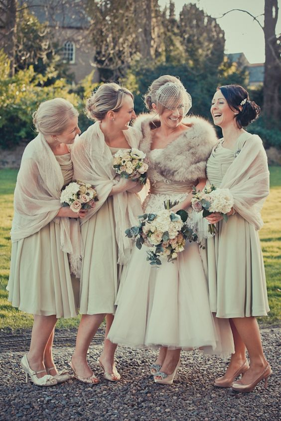 tea length dresses and pashminas in the same ivory shade for a vintage wedding