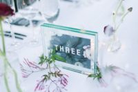 30 double acrylic table numbers printed on green paper for a serene tablescape