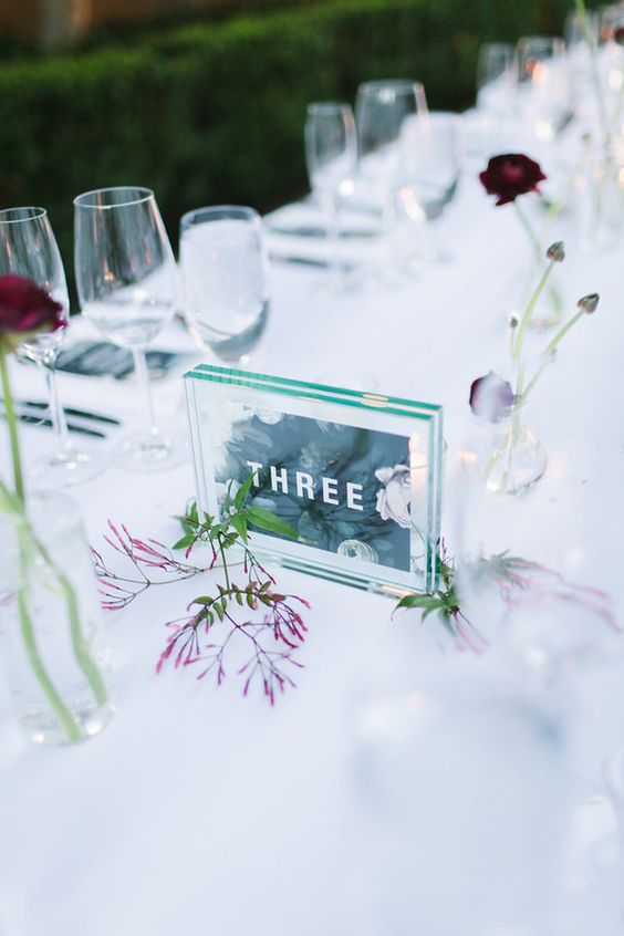 double acrylic table numbers printed on green paper for a serene tablescape