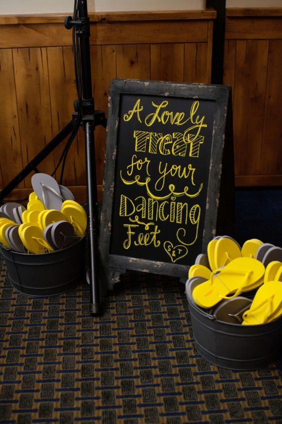 grey and yellow flip flops for guests to dance
