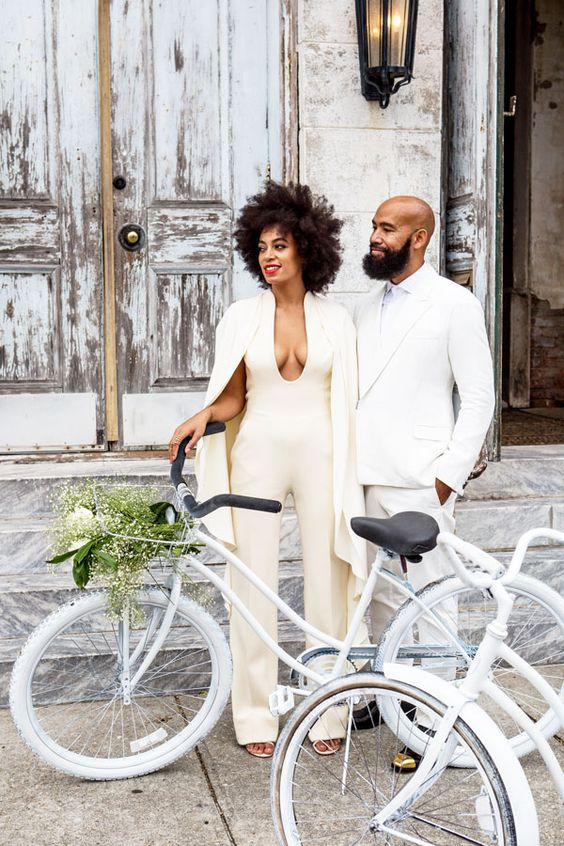ivory pantsuit with a cape was worn by Solange Knowles