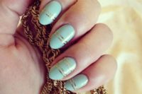 30 mint nails with gold stripes