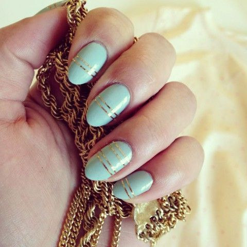 mint nails with gold stripes