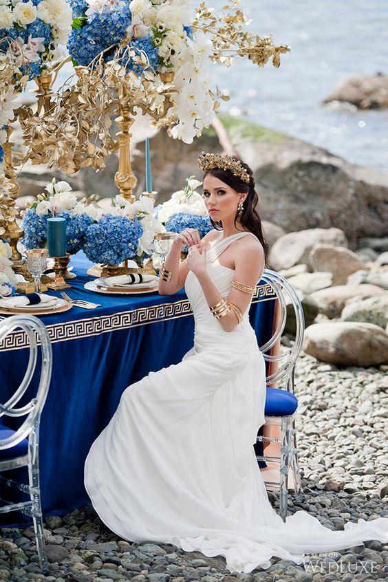 white draped one shoulder wedding dress