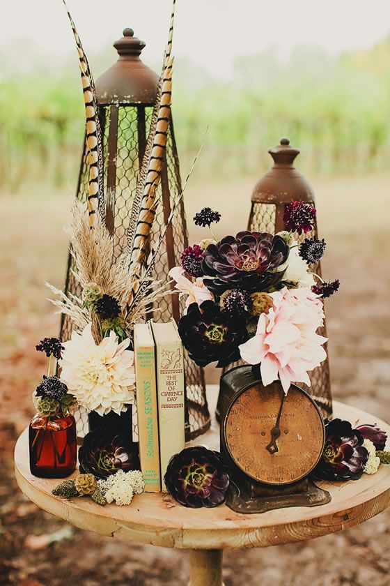 A Wedding Centerpiece With Vintage Books An Antique Clock Stunning Peonies And Succulents