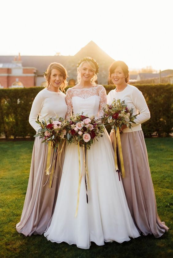 bridesmaids' separates with white sweaters and taupe skirts