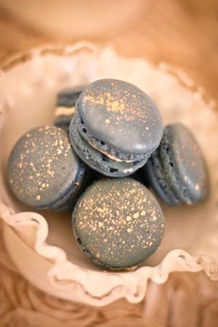 dark grey macarons with gold sprinkles
