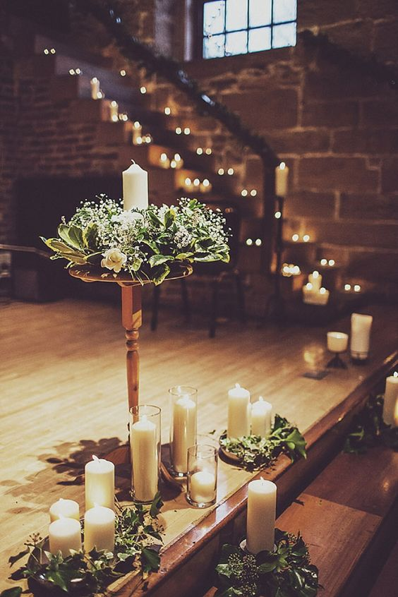 decorate your venue with cool fresh wreaths with a candle inside