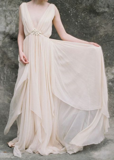 flowing peach-colored wedding dress with a deep V-neckline