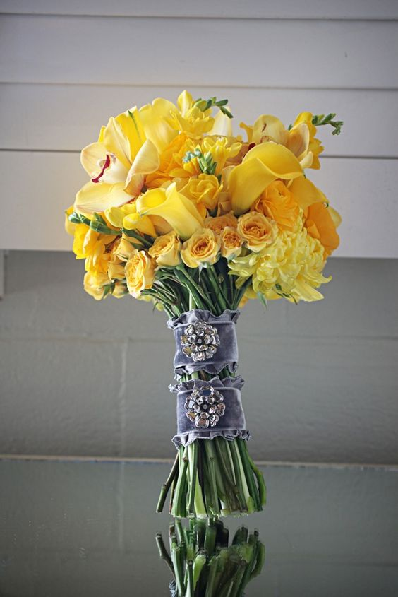 sunny yellow bouquet with grey velvet wraps