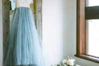 32 bridal separate with a white lace top and a blue skirt