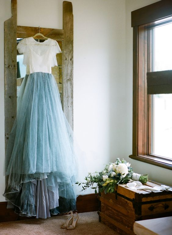 bridal separate with a white lace top and a blue skirt