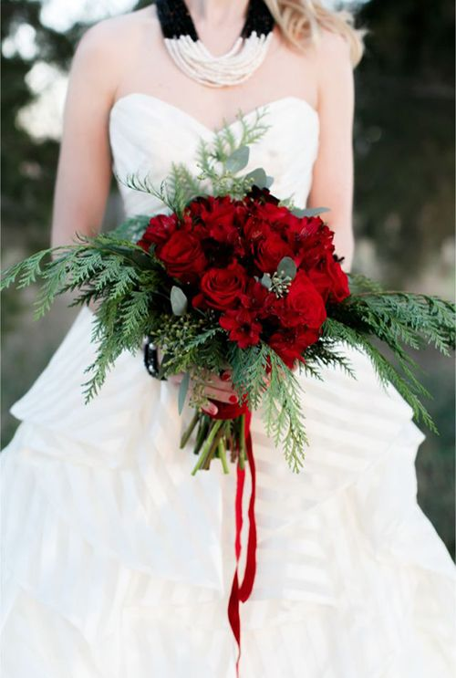 dark red bridal bouquet with evergreens