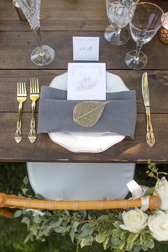 gold and grey place setting with crispy white