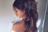 32 messy curly ponytail with a large bead headpiece