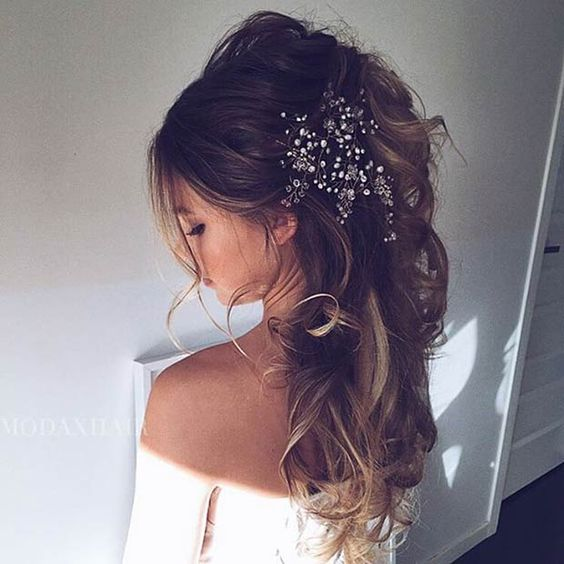 messy curly ponytail with a large bead headpiece