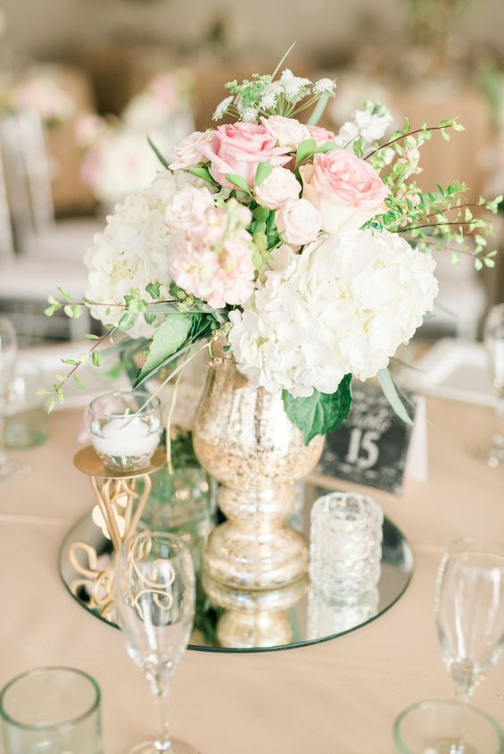 white and pink flower mirror wedding centerpiece with candles