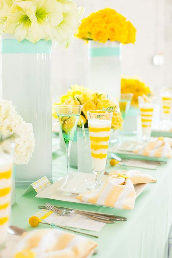 yellow flowers, billy balls and glasses, mint dished and a tablecloth