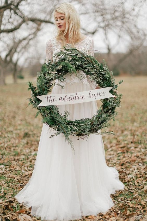 fir winter wedding wreath with a sign