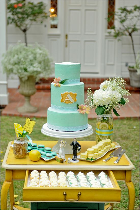 mint wedding cake and macarons, a yellow table