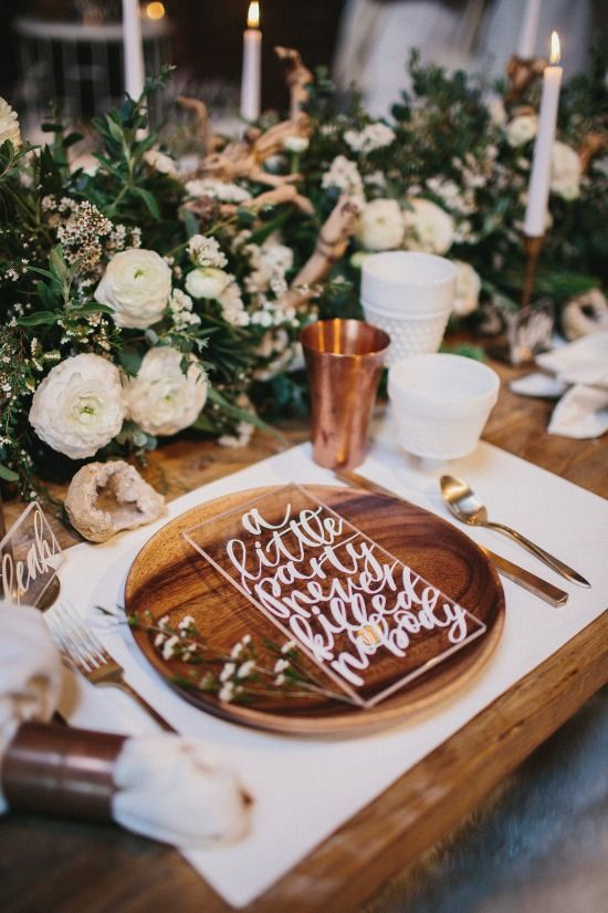 wooden place settings, hand lettering, lush foliage styled arrangements and a copper cup