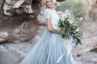 34 dusty blue skirt with a train and a white lace top