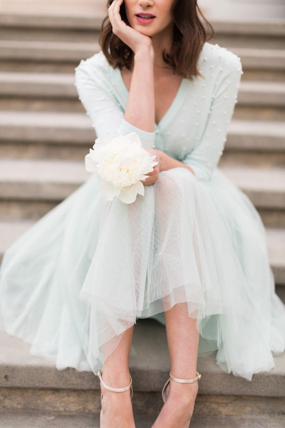 mint bridesmaid's separate with a tulle skirt and a sweater