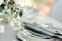 34 soft grey linens, rose gold flatware, and white berries make an elegant tablescape