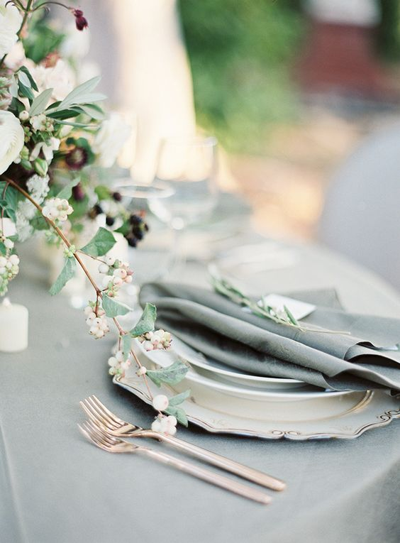 soft grey linens, rose gold flatware, and white berries make an elegant tablescape
