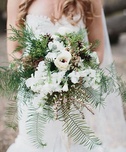 textural bridal wubter bouquet with evergreens, fern and flowers